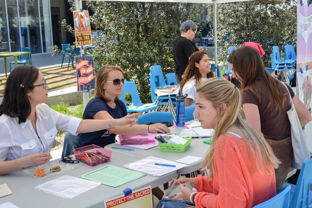 "San Diego Mesa College's Women's Studies Advisory Committee, Women in Science Club and Women's Alliance Club held a ""Get Your Voice Heard"" action booth event as part of the March Women's History Month Events on March 14 in the Mesa Commons Quad."